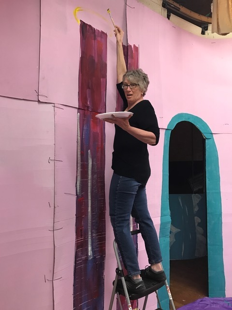 Volunteer Jen Doney painting the play set.