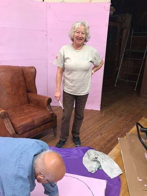 Volunteer Donna Jones painting the play set.