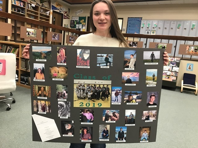 Kylie Noack and the Senior class display for the high school lobby.