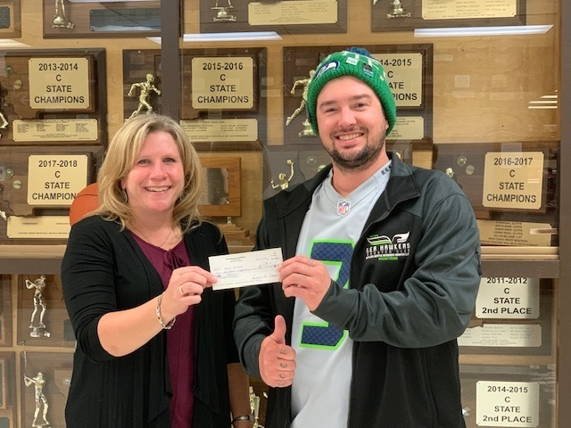 David from the Sea Hawkers group hands Principal Mellissa Newman a check for EHS.
